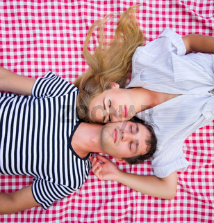 Young couple lying at plaid