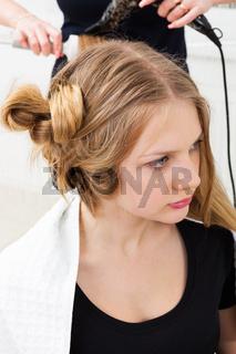 Hair styling in hair salon