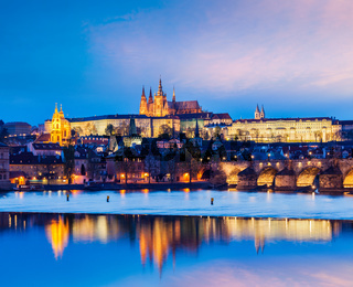 Travel Prague Europe concept background - view of Charles Bridge and Prague Castle in twilight. Prague