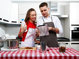 Couple at kitchen with tablet pc