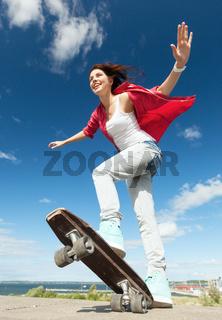 teenage girl skating outside