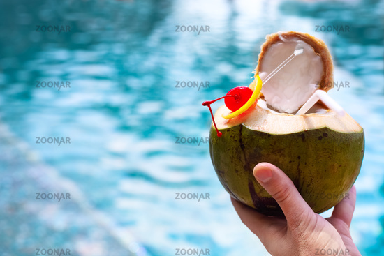 Man holding coconut cocktail