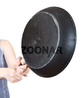frying pan in female hands close up
