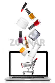 Woman cosmetics falling into notebook isolated on white. Shoppin