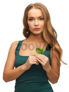woman with spinach leaves
