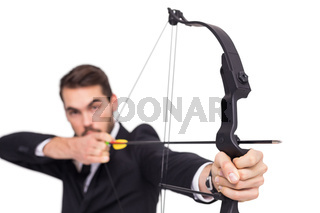 Close up of businessman shooting bow and arrow