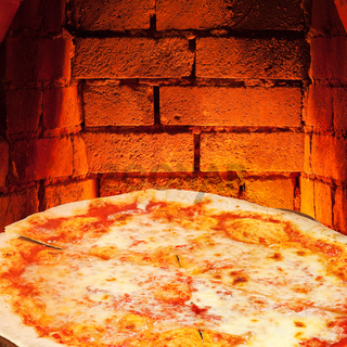 pizza margherita and hot brick wall of oven