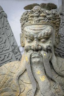 Chinese stone statue in Wat Pho, Bangkok, Thailand Chinese stone statue in Wat Pho, Bangkok, Thailand