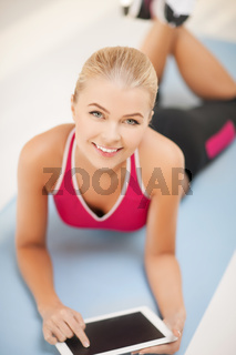 woman lying on the floor with tablet pc