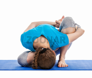 Yoga - young beautiful slender woman yoga instructor doing Forward Bends Sage Twist B pose (Marichyasana B) asana exercise isolated on white background