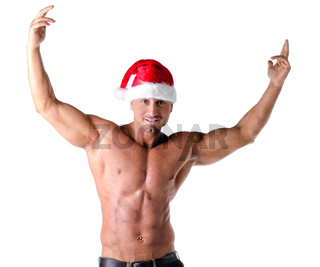 Muscular shirtless man with Santa Claus red hat