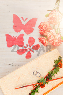 Wedding invitation with flowers and butterflies