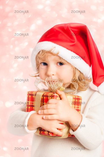 Baby holding Christmas gift in hands