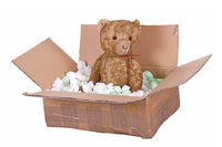 teddy bear in cardboard box