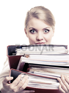 Paperwork. Businesswoman carrying stack of documents
