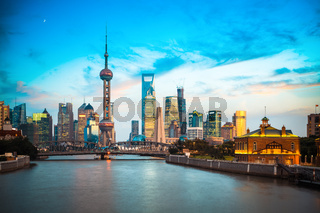 dusk scene of shanghai skyline and suzhou river