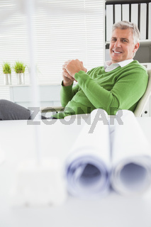 Casual businessman looking at camera