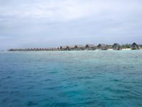 Water villas in vivid clear sea water