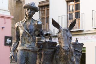 Skulptur Mann mit Esel