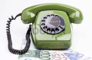 Analoges Telefon und Geldscheine