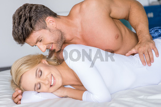 Sweet Sexy Caucasian Couple Lying on White Bed