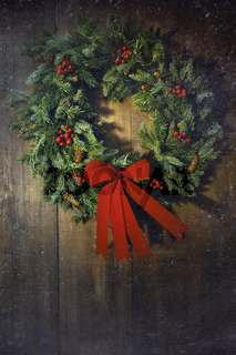Christmas wreath on the wood background