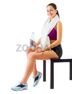 Young sporty girl on with water bottle