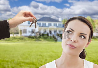 Agent Handing Mixed Race Woman Keys In Front of House