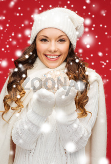 woman in hat and mittens with christmas ball