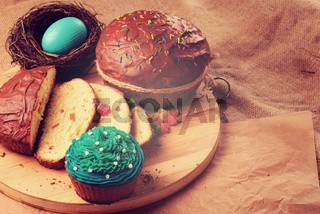 Easter bread and  cakes on the wooden table