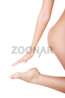 Closeup on feet and hand, buttock, naked female body.