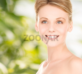 close up of smiling woman over green background