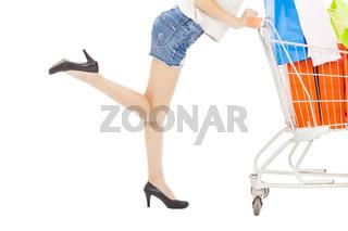 sexy body of woman pushing a shopping cart