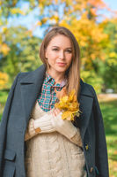 Pretty Woman in Autumn Fashion Looking at Camera