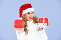 Cute blond woman in a Santa hat