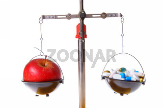 Red apple vs. food supplements