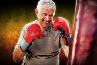 Composite image of portrait of a determined senior boxer
