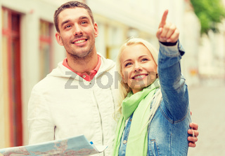 happy couple with map exploring city