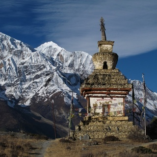 Stupa and Gangapurna, scene in the Annapurna Conservation Area, Nepal