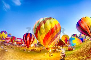 Bright Hot Air Balloons Glowing at Night