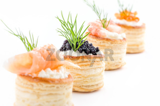 Pastries with salmon, caviar and shrimp