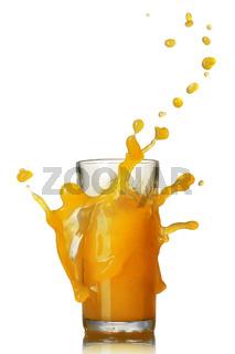 orange juice splash in the glass isolated on white