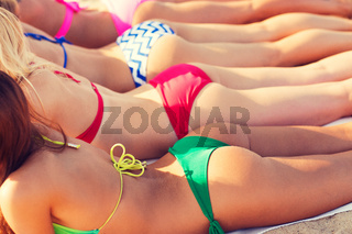 close up of young women lying on beach