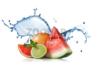 Watermelon, grapefruit and lime with mint and water splash isolated on white