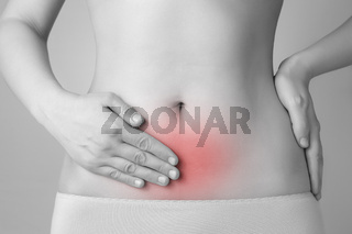 Young woman having abdominal pain