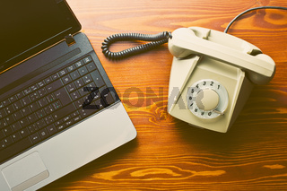 retro phone and modern laptop