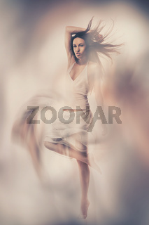 Fine art photo of woman in white dress