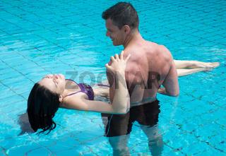 Romantic couple at swimming pool