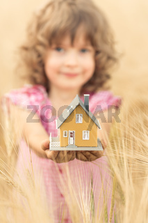 Child holding house in hands