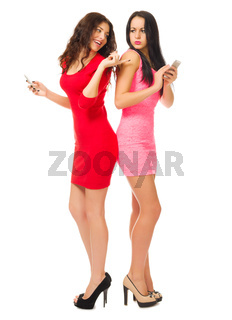Two young girls with mobile phones isolated